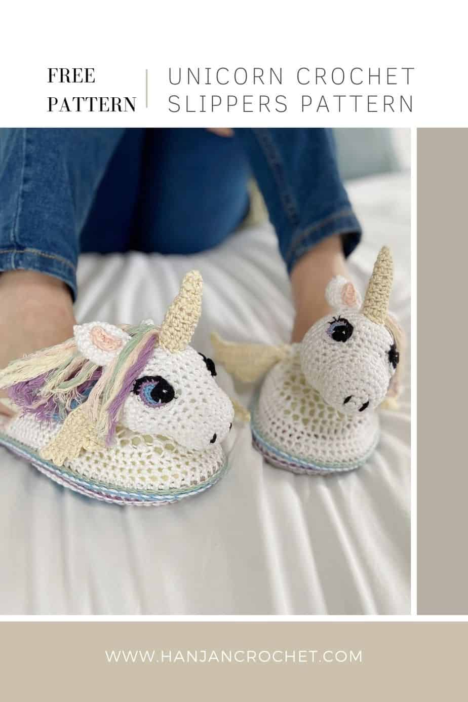 pair of unicorn crochet slippers being worn by someone in jeans sitting on a bed