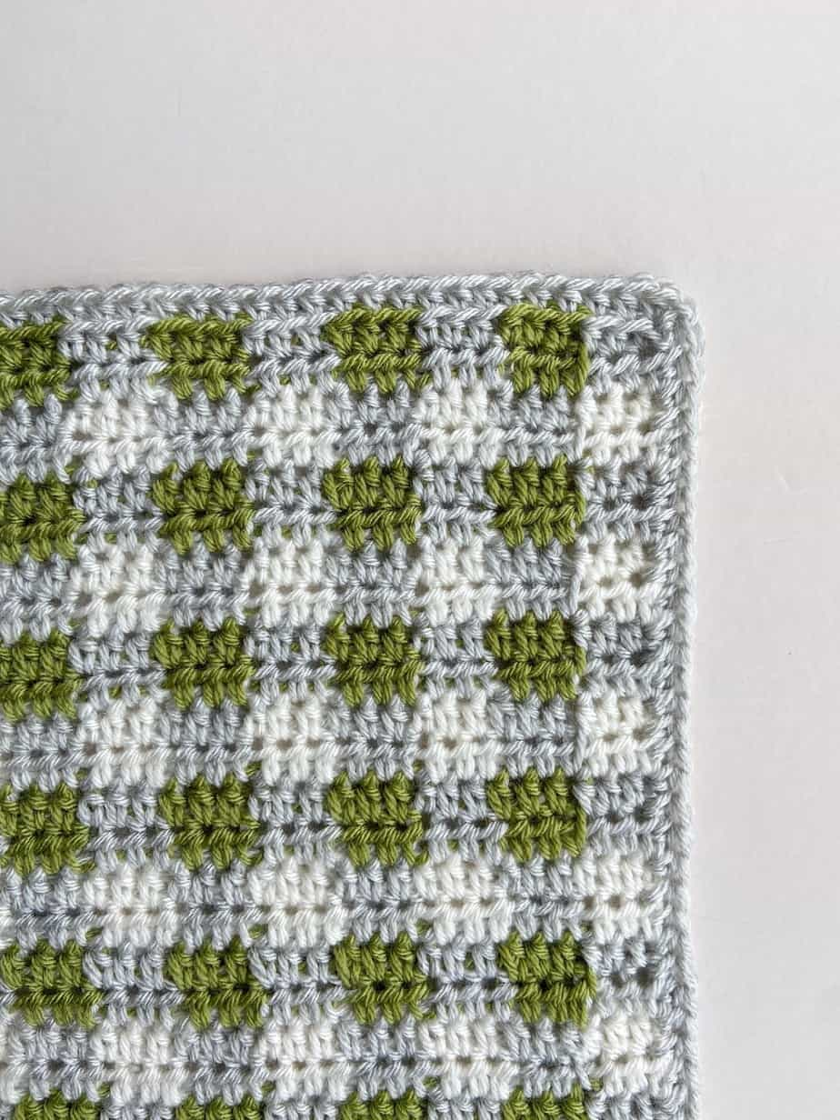 close up of crochet plaid blanket corner and border