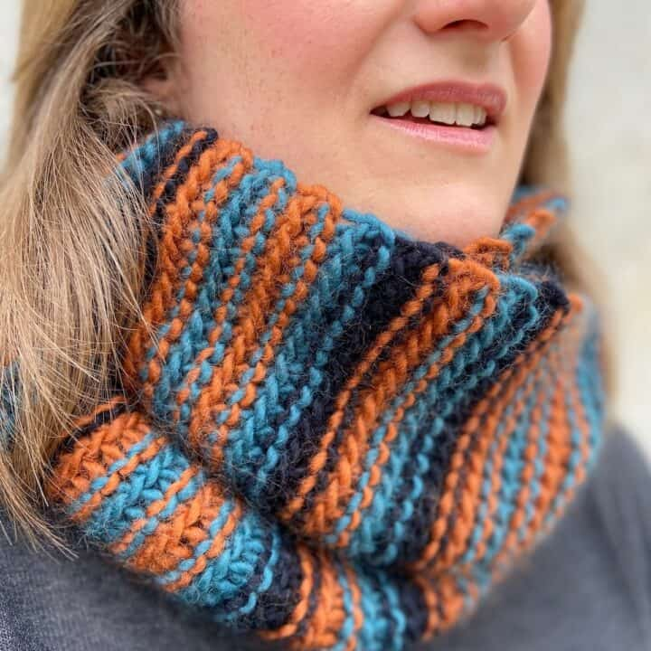 woman wearing striped chunky crochet cowl