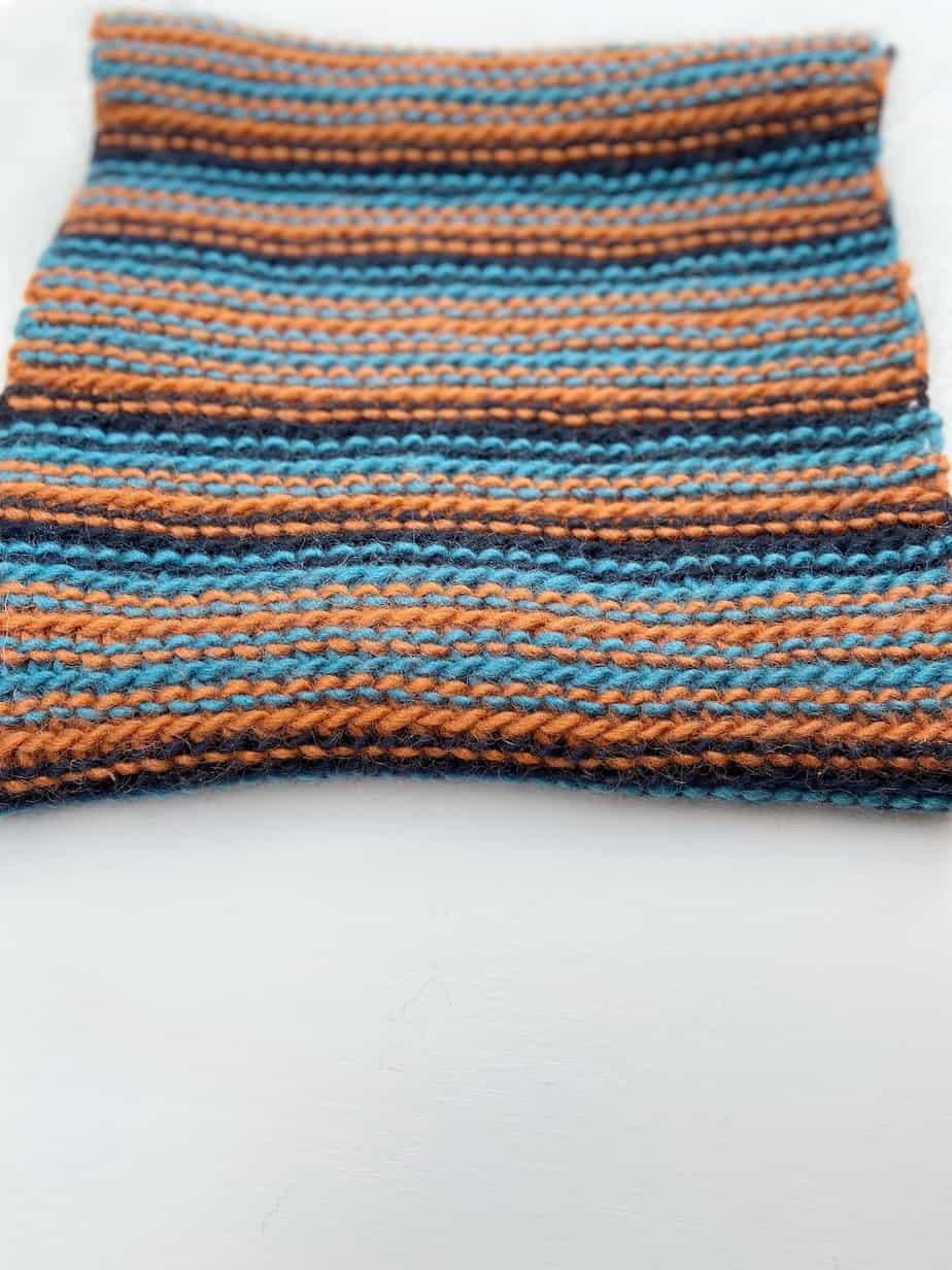 close up of chunky crochet slip stitch cowl looking like knitting
