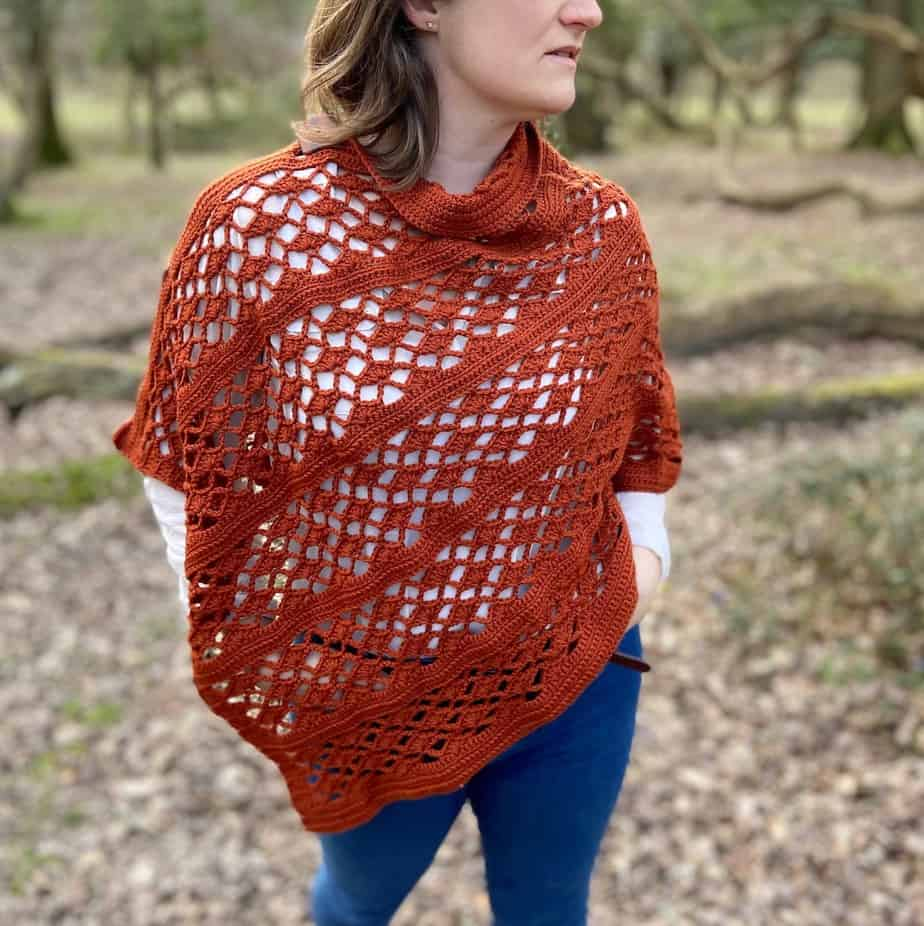 woman looking sideways wearing picante crochet wrap patterns and jeans