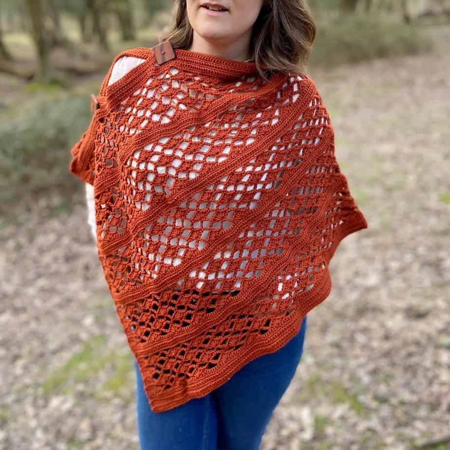 woman wearing lace crochet poncho style wrap